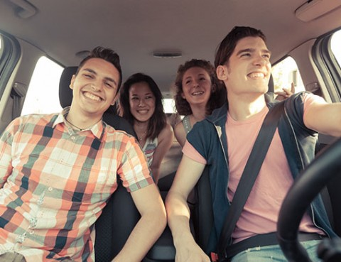 Young adults in a car traveling