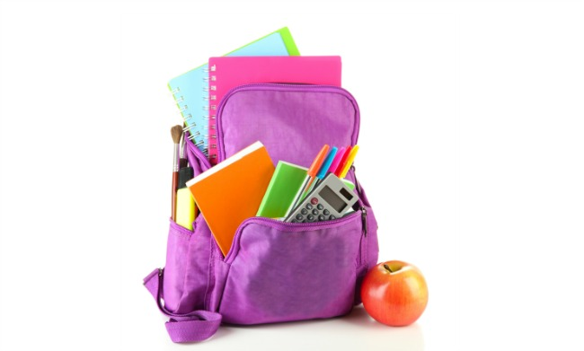 A school backpack full of folders, pins and notebooks